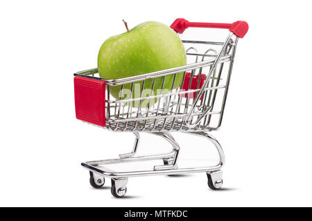top view closeup of shiny aluminum empty miniature shopping supermarket cart with one green apple inside isolated on white background - Stock Photo