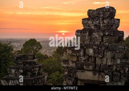 Sunset at Phnom Bakheng Temple, Angkor Wat, Cambodia. - Stock Photo