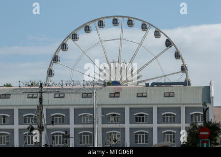 Ferris wheel at Capetown harbour over traditional architecture, Capetown, South Africa - Stock Photo