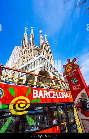 BARCELONA, SPAIN - April 25, 2018: Barcelona city tour touristic bus with tourists near famous Sagrada Familia Basilica. Unfinished work of Catalan architect Antoni Gaudi - Stock Photo
