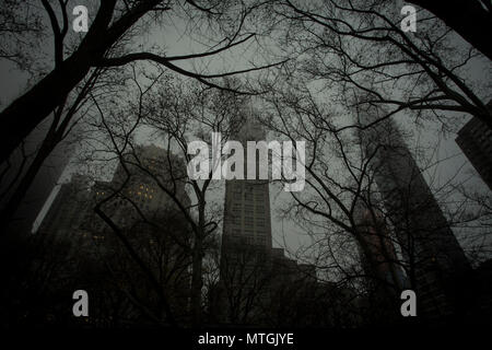 NEW YORK, NY/USA - December 27, 2015: Buildings in midtown Manhattan in foggy early morning. - Stock Photo