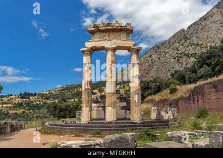 Ruins and Athena Pronaia Sanctuary at Ancient Greek archaeological site of Delphi, Central Greece - Stock Photo