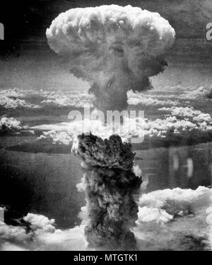 Atomic Cloud Rises Over Nagasaki, Japan - Mushroom cloud above Nagasaki after atomic bombing on August 9, 1945. Taken from the north west. - Stock Photo