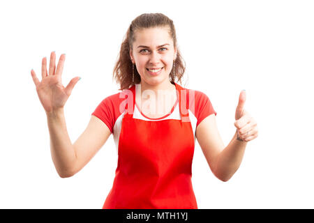 Young woman supermarket employee or storekeeper showing number six with fingers as counting retail worker concept isolated on white background - Stock Photo