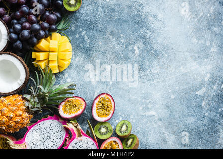 Fresh tropical fruits exotic fruits on concrete background with copy space. Food background. Vegan, summer, healthy eating and healthy lifestyle conce - Stock Photo
