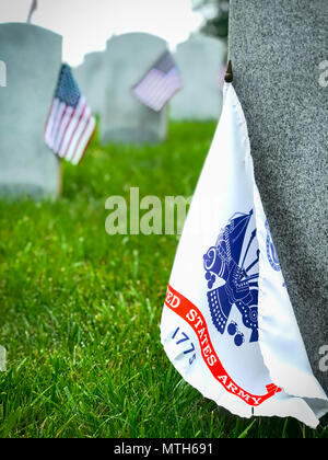 Decorated graves of US military service members at a Virginia cemetery. - Stock Photo