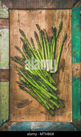 Raw uncooked green asparagus - Stock Photo
