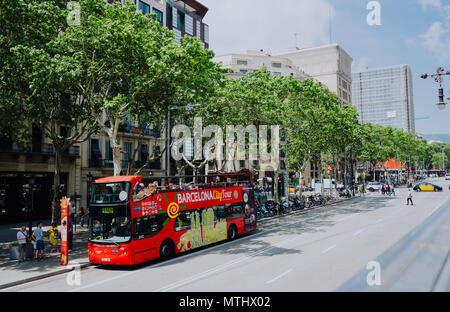 BARCELONA, SPAIN - April 26, 2018: Barcelona city tour touristic bus with tourists on the route around Barcelona, Spain - Stock Photo