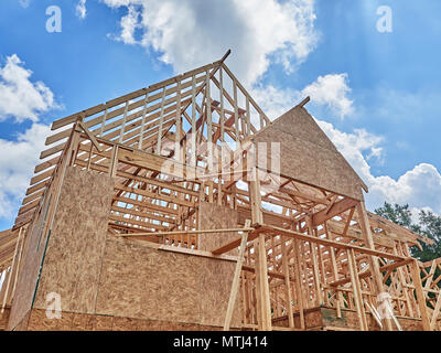 Exterior of framed residential house under construction in a subdivision in Montgomery Alabama, USA. - Stock Photo