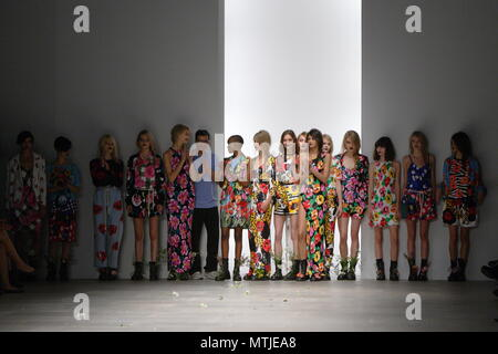 UK Fashion - Fashion designer Ashish Gupta with the Models on the runway for the Ashish Spring Summer collection and Fashion Show. London Fashion Week 2011 - Stock Photo