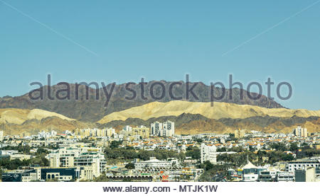 View of Eilat, Israel and Aqaba, Jordan with the hills of Aqaba in the background. - Stock Photo