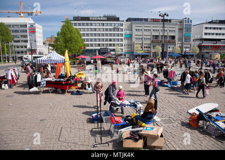 Cobblestoned Kuopio market place is right in the city center. On four occasions each summer, anyone may rent a spot for flea market sales. - Stock Photo