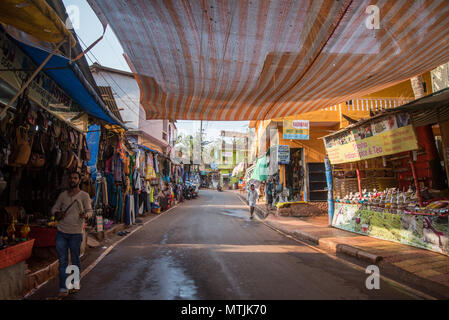 Arambol, Goa, Iindia - March 22, 2017: Street shops of sale of souvenirs and clothes for tourists - Stock Photo