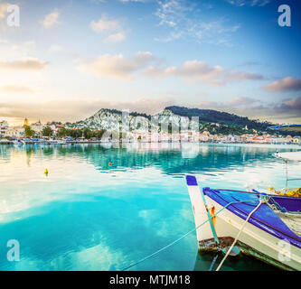 fishing boats in Zaante town harbour under sunset sky, Zakinthos Greece, toned - Stock Photo