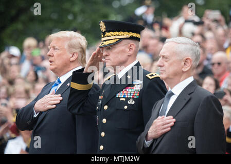 President Donald J. Trump, Commanding General of the Military District of Washington U.S. Army Maj. Gen. Michael L. Howard, and Secretary of Defense James N. Mattis render honors  during the Presidential Wreath Laying ceremony at the Tomb of the Unknown Soldier as part of the 150th annual Department of Defense (DoD) National Memorial Day Observance hosted by the Secretary of Defense at Arlington National Cemetery, May 28, 2018. Senior leadership from around the DoD gathered to honor America's fallen military service members. (DoD Photo by U.S. Army Sgt. James K. McCann) - Stock Photo