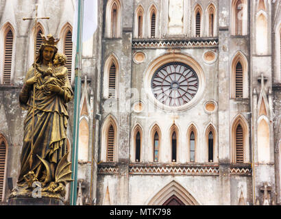 Regina Pacis (Queen of Peace) Statue in front of St. Joseph's Cathedral, Hanoi, Vietnam. St. Joseph's Cathedral is a Neogothic style church that serve - Stock Photo