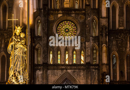 Night view of Regina Pacis (Queen of Peace) Statue in front of St. Joseph's Cathedral, Hanoi, Vietnam. St. Joseph's Cathedral is a Neogothic style chu - Stock Photo