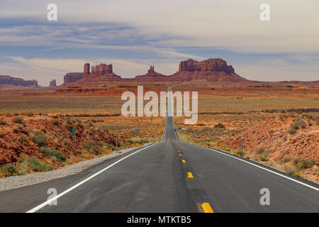 This famous Highway 163 travels toward the Monuments in Utah and Arizona. Desert valley landscape American West - Stock Photo