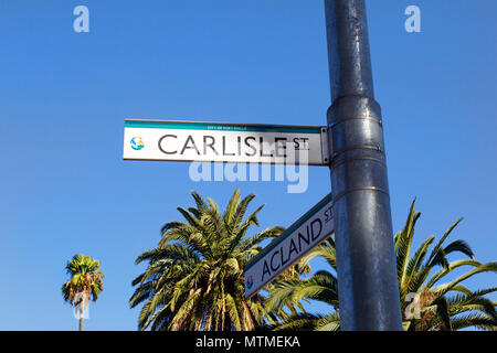Melbourne, Australia: April 13, 2018: Street sign for Carlisle Street with a City of Port Phillip insignia. - Stock Photo