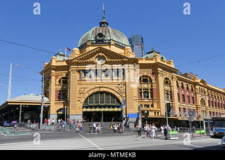Melbourne, Australia: March 08, 2017: Street view of Flinders Street Station in Federation Square. - Stock Photo