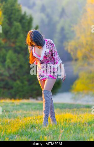 Natural environment one single young woman skimpy micro tiny underclothed - Stock Photo