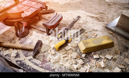 Topl view of carpenter tools:hammer,meter,nails,shavings, and chisel  equipment set on wooden table - Stock Photo