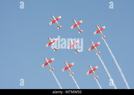 PC-7 team doing stunts at an airshow in Belgium. - Stock Photo