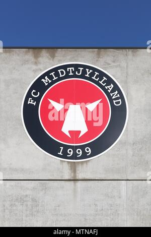 Herning, Denmark - May 13, 2018: FC Midtjylland logo on a wall of the MCH arena. FC Midtjylland is a Danish football club  based in Herning, Denmark - Stock Photo