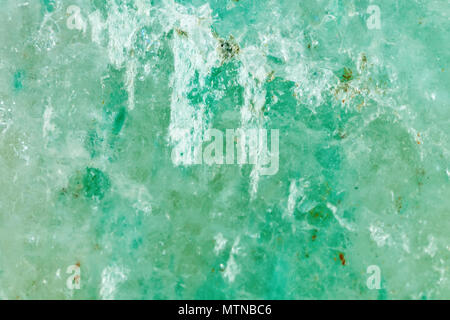 The mineral is jadeite. The texture of the mineral. Macro shooting of natural gemstone. The raw mineral. Abstract background. - Stock Photo