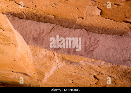 Red hand print pictographs created by Ancestral Puebloans in Bears Ears National Monument in Southeastern Utah, United States - Stock Photo