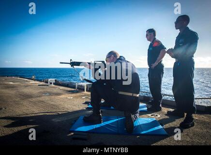 170109-N-BL607-145  ATLATIC OCEAN (Jan. 9, 2017) Sailors assigned to the guided-missile cruiser USS Monterey (CG 61) fire the M-16 rifle during a small arms qualification. Monterey, deployed as part of the Eisenhower Carrier Strike Group, is conducting naval operations in the U.S. 6th Fleet area of operations in support of U.S. national security interests in Europe.  (U.S. Navy photo by Mass Communication Specialist 2nd Class William Jenkins) - Stock Photo