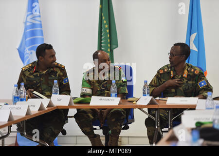 Somali National Army Chief of Defense Forces Maj. Gen. Mohammed Adan Ahmed, right, and Chief of Staff Col. Ahmed Mohammed, left, converse with African Union Mission in Somalia Force Commander Lt. Gen. Osman Noor Soubagleh during the SNA Symposium in downtown Mogadishu, Jan. 12, 2017. The symposium is part of an ongoing international effort to aid security conditions throughout Somalia by fostering the growth and revitalization of the national military defense force, which disbanded following the collapse of the country's central government in 1991. - Stock Photo