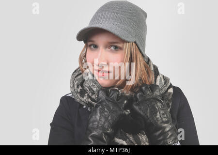Portrait of a beautiful young woman in winter clothing - Stock Photo
