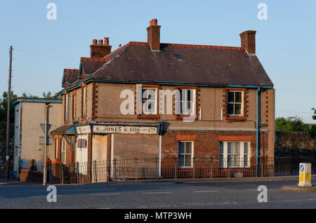 Flint, UK: May 22, 2018: A boarded up and derelict shop and newsagent. Symbolic of the decline of small family retail stores. - Stock Photo