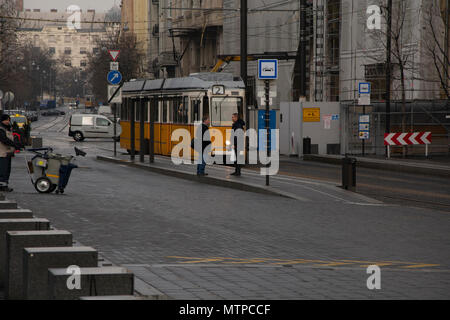 Budapest Hungary, 7th February 2018. Street Scene in Budapest, Two commuters wait for the tram to stop. - Stock Photo
