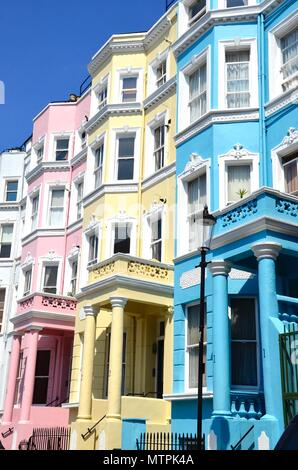 A row of  colourful houses in Notting Hill, London, England - Stock Photo
