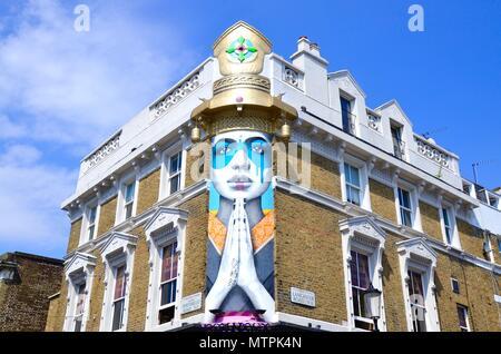 Artwork above a restaurant on Portobello Road in Notting Hill, London, England, UK - Stock Photo