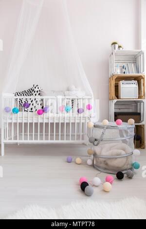 Shot of a simple modern nursery room - Stock Photo