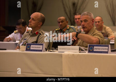 U.S. Marine Corps Lt. Gen. Brian Beaudreault, deputy commandant, Plans, Policies, and Operations, Headquarters Marine Corps, asks a question during the Pacific Amphibious Leaders Symposium (PALS) 2018 in Honolulu, Hawaii, May 22, 2018. PALS brings together senior leaders of allied and partner militaries with significant interest in the security and stability of the Indo-Pacific region to discuss key aspects of maritime/amphibious operations, capability development, crisis response, and interoperability. (U.S. Marine Corps photo by photo Cpl. Makenzie Fallon) - Stock Photo