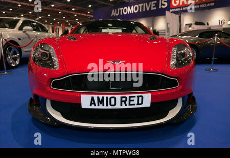 Three-quarter front view of, one of the,  Red Arrows Edition Aston Martin Vanquish S, on the RAF Benevolent Fund Stand, at the 2018 London Motor Show - Stock Photo