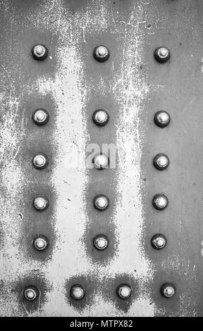 Old steel plate with rivets, industrial abstract background. - Stock Photo