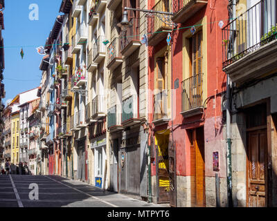 The colourful Calle del Carmen leads from the Portal de Francia to the city centre - Pamplona, Navarre, Spain - Stock Photo