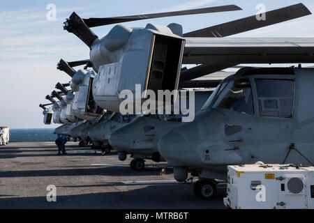 MV-22 Ospreys with the 24th Marine Expeditionary Unit set aboard USS Bataan (LHD 5) during Composite Unit Training Exercise Jan. 14, 2017. COMPTUEX is the MEU's final at-sea evaluation designed for Marines and Sailors to increase operational efficiency for deployment. (U.S. Marine Corps photo by Cpl. Brianna Gaudi) - Stock Photo