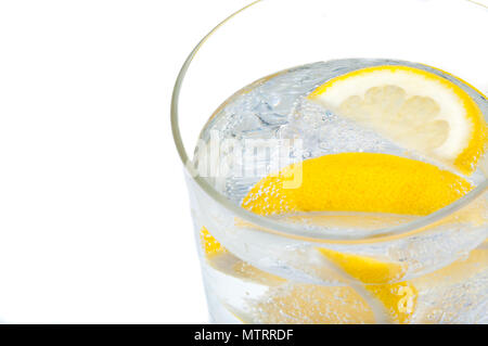 A glass beaker with crystal clear water, lemon and ice cubes. - Stock Photo