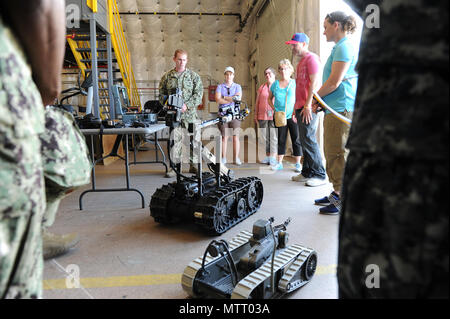 180523-N-PX557-015  VIRGINIA BEACH, Va.  (May 23, 2018)  Chief Explosive Ordnance Disposal Technician Matthew Wehr, assigned to Explosive Ordnance Disposal Expeditionary Support Unit Two, performs a demonstration of Standard Talon (2 DOF) and iRobot SUG-V 310 robots, during a tour at Joint Expeditionary Base Little Creek-Fort Story for Naval Supply Systems Command (NAVSUP) Business Systems Center (BSC) personnel. The tour was part of NAVSUP BSC's Meet the Fleet, a four-day event held May 21-24 in the Hampton Roads, Va., area of operation, and served as an opportunity for personnel to directly  - Stock Photo
