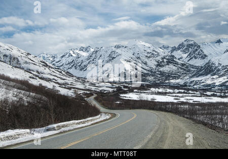 Alaska Mountain Byway:  A narrow road descends from Hatcher Pass in the mountains east of Anchorage. - Stock Photo