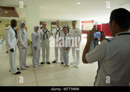 180522-N-MW280-097 KOTA KINABALU, MALAYSIA (May 22, 2018) Members of the U.S. 7th Fleet Band pose for for photos with hospital staff at Queen Elizabeth Hosptial in Kota Kinabalu, Malaysia after a performance. The band is supporting a U.S. 7th Fleet theater security cooperation mission and will be traveling to several Indo-Pacific countries in the coming weeks. (U.S. Navy photo by Mass Communication Specialist 2nd Class Chase Hawley/Released) - Stock Photo