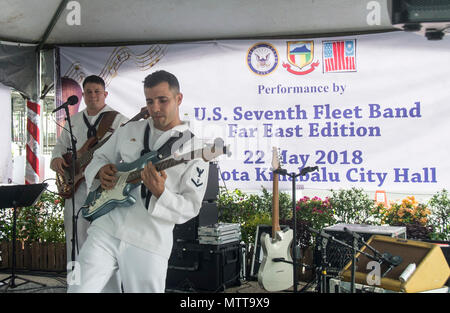 KOTA KINABALU, MALAYSIA (May 22, 2018) Musician 3rd Class Victor Martinez (front) and Musician 2nd Class Joshua Haney of the U.S. 7th Fleet Band perform at City Halll in Kota Kinabalu, Malaysia. The band is supporting a U.S. 7th Fleet theater security cooperation mission and will be traveling to several Indo-Pacific countries in the coming weeks. (U.S. Navy photo by Mass Communication Specialist 2nd Class Chase Hawley/Released) - Stock Photo