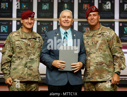 "Inductee Command Sgt. Maj. (ret) William ""Joe"" Gainey (center), former Senior Enlisted Advisor to the Chairman of the Joint Chiefs of Staff, poses for a photo with Maj. Gen. Erik Kurilla (right), commander of the 82nd Airborne Division, and Command Sgt. Maj. Michael Ferrusi (left), 82nd Airborne Division command sergeant major, during the 82nd Airborne Division Hall of Fame inaugural induction ceremony May 23, at Fort Bragg, North Carolina. The Hall of Fame honors past members of the division who made a lasting impact and oftentimes went on to have long successful careers in the U.S. Army. (U. - Stock Photo"