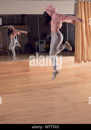 Female dancer dancing in dance studio - Stock Photo